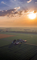 An aerial view via drone of the sunrise over a farm in northwest Ohio. BEELINE AERIAL