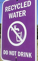 A sign warns that the water used to irrigate a tree farm in Lewis County doesn't meet drinking standards. The Washington Department of Ecology has proposed a rule for how wastewater, also known as recycled or reclaimed water, can be used for agricultural irrigation. DON JENKINS