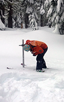 Julie Koeberle, a hydrologist with the U.S. Department of Agriculture's Natural Resources Conservation Service, and Dan Fries, hydrologic technician, measure the natural snowpack at a survey station at the Timberline Lodge on Dec. 29, 2015. TONY HERNANDEZ